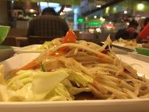 Papaya salad. Green papaya salad east culture Royalty Free Stock Photo