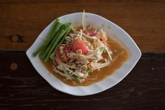 Papaya Salad. Green papaya salad is a spicy salad made from shredded unripe papaya. Probably originating from ethnic Lao peoples living in present-day Thailand stock photo
