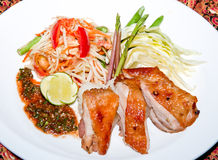 Papaya salad with grill chicken Stock Images