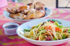 Papaya salad. And Grilled Chicken food thailand Royalty Free Stock Image
