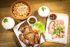 Papaya  salad  , Grilled chicken , Grilled pork and  rice Royalty Free Stock Photo