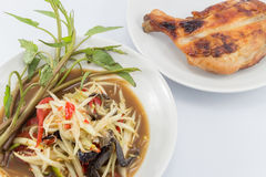 Papaya salad and Grilled Chicken. On white plate Royalty Free Stock Images
