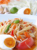 papaya salad with ingredients in the background Stock Image