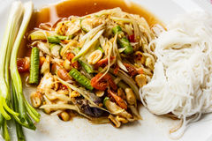 Papaya salad. And noodle and vegetable on plate Stock Image