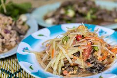 Papaya salad or Papaya Pok Pok (Som tum). For sale at Thai street food market or restaurant in Thailand Royalty Free Stock Photo