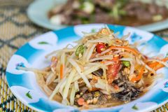 Papaya salad or Papaya Pok Pok (Som tum). For sale at Thai street food market or restaurant in Thailand Royalty Free Stock Photography