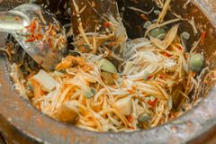 Papaya salad, papaya salad, papaya salad, Thai cooking ingredients and peeled papaya to serve as food and for sale to consumers. stock photo