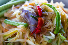 Papaya salad Pickled Fish. Close-up of papaya salad, which put Pickled Fish and long beans Royalty Free Stock Photography