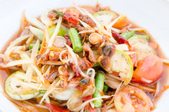 Papaya salad with pickled shellfish Stock Photo