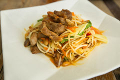 Papaya salad roasted pork. Closeup Royalty Free Stock Photos