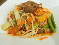 Papaya salad roasted pork. Closeup Royalty Free Stock Photo
