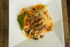 Papaya salad roasted pork. Closeup Stock Photography