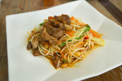 Papaya salad roasted pork. Closeup Stock Photos