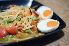 Papaya salad with salted egg. Famous Thai food Papaya salad with salted egg or what we called `Somtum Kai-Kem` in Thai Language Royalty Free Stock Image