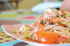 Papaya salad seafood. Traditional and famous dishes of Thailand. Raw papaya, chopped and sliced into a mortar. Season with sugar and fish sauce, lime, fresh Stock Images