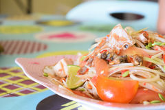 Papaya salad seafood. Traditional and famous dishes of Thailand. Raw papaya, chopped and sliced into a mortar. Season with sugar and fish sauce, lime, fresh Royalty Free Stock Image