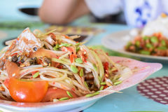 Papaya salad seafood. Traditional and famous dishes of Thailand. Raw papaya, chopped and sliced into a mortar. Season with sugar and fish sauce, lime, fresh Stock Photography