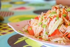 Papaya salad seafood. Traditional and famous dishes of Thailand. Raw papaya, chopped and sliced into a mortar. Season with sugar and fish sauce, lime, fresh Royalty Free Stock Photo