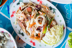 Papaya salad with seafood. Thai popular food and spicy taste, it mixed with papaya, chili, lemon, carrot, garlic, sugar, bean and meal Stock Photography