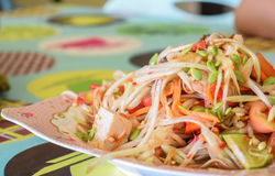 Papaya salad seafood. Traditional and famous dishes of Thailand. Raw papaya, chopped and sliced into a mortar. Season with sugar and fish sauce, lime, fresh Stock Photo