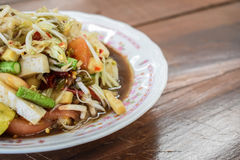 Papaya salad seafood. Traditional and famous dishes of Thailand. Raw papaya, chopped and sliced into a mortar. Season with sugar and fish sauce, lime, fresh Royalty Free Stock Images