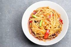 Papaya salad. (Som-tam) in dish on table Stock Image