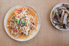 Papaya salad or som-tam Thai local food. Papaya salad or som-tam on wood table, Thai local food Royalty Free Stock Photo