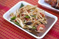 Papaya salad Som-tam. Thai popular food. Papaya salad on thai mat. Traditional spicy Thai food is a popular food in Thailand royalty free stock photo