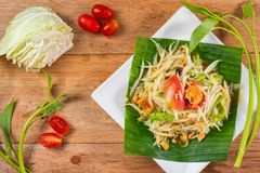Papaya salad Som Tam traditional thai food. Papaya salad Som Tam on wooden table, traditional Thai food stock image