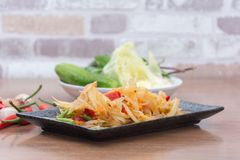 Papaya salad som tum thai. On plate stock photos