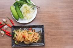 Papaya salad som tum thai. On plate royalty free stock photography