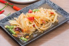 Papaya salad som tum thai. On plate royalty free stock image