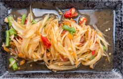 Papaya salad som tum thai. On plate royalty free stock photo