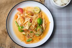 Papaya salad som tum thai on plate. Top view stock photography