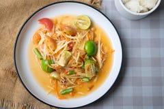 Papaya salad som tum thai on plate. Top view stock photography