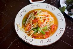 Papaya salad som tum Thai on plate. Papaya salad som tum Thai on wooden table Stock Photo