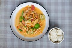 Papaya salad som tum thai on plate. Som tum Thai spicy green papaya eat couple sticky rice on plate stock photography