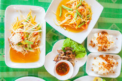 Papaya salad (som tum Thai). With sticky rice and grilled beef stock image