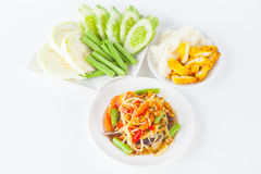Papaya salad. (som tum Thai) with sticky rice and grilled chicken on white paper background royalty free stock photos