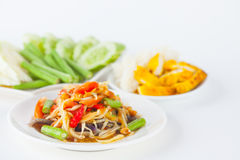 Papaya salad. (som tum Thai) with sticky rice and grilled chicken on white paper background royalty free stock image