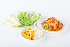 Papaya salad. (som tum Thai) with sticky rice and grilled chicken on white paper background Stock Photo