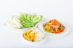 Papaya salad. (som tum Thai) with sticky rice and grilled chicken on white paper background stock photography