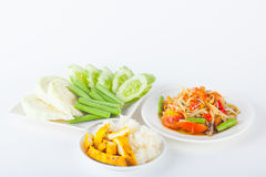 Papaya salad. (som tum Thai) with sticky rice and grilled chicken on white paper background Stock Photos