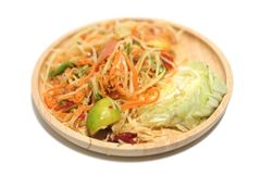 Papaya salad som tum. Thai traditional food. On wood dish stock photos
