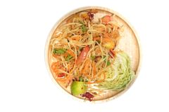 Papaya salad som tum. Thai traditional food. On wood dish royalty free stock photos
