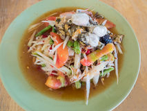 Papaya Salad Som tum Thai. Papaya Salad Som tum Thai on wood table Royalty Free Stock Photography