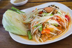 Papaya Salad (Som tum Thai) on wood table Stock Photos