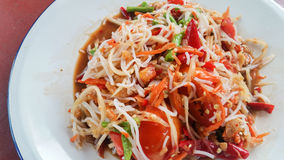 Papaya Salad (Somtum) with rice vermicelli, Thai foods. On table stock images
