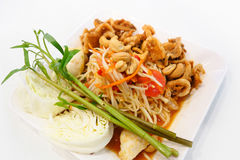 Papaya salad somtum. Papaya salad somtum with salted eggs and fried pork rind Stock Images