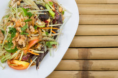 Papaya salad spicy with crabs and dry small shrimps - Tam Korat Stock Images